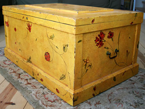 Antique hinged-top trunk